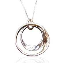 Inner silver mobius and outer 9ct gold mobius set of pendants